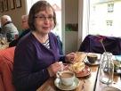 Val enjoying cake in Husid